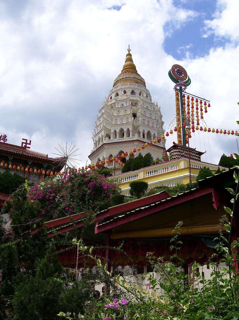 White pagoda blue sky clouds