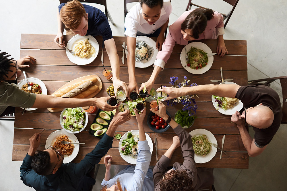 People toasting over meal