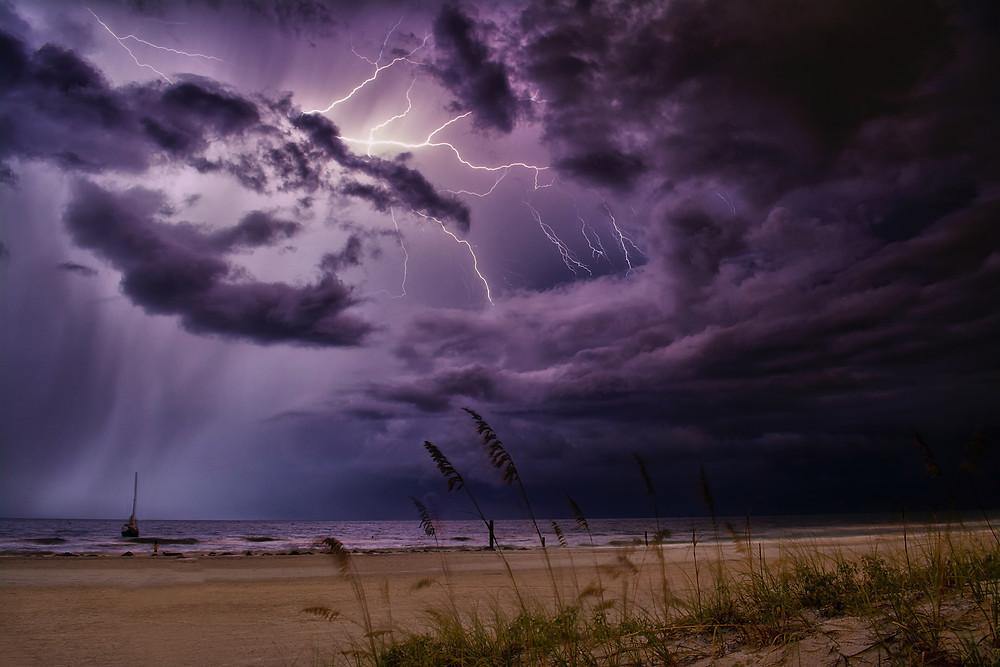 Lightning over ocean in a dark night.
