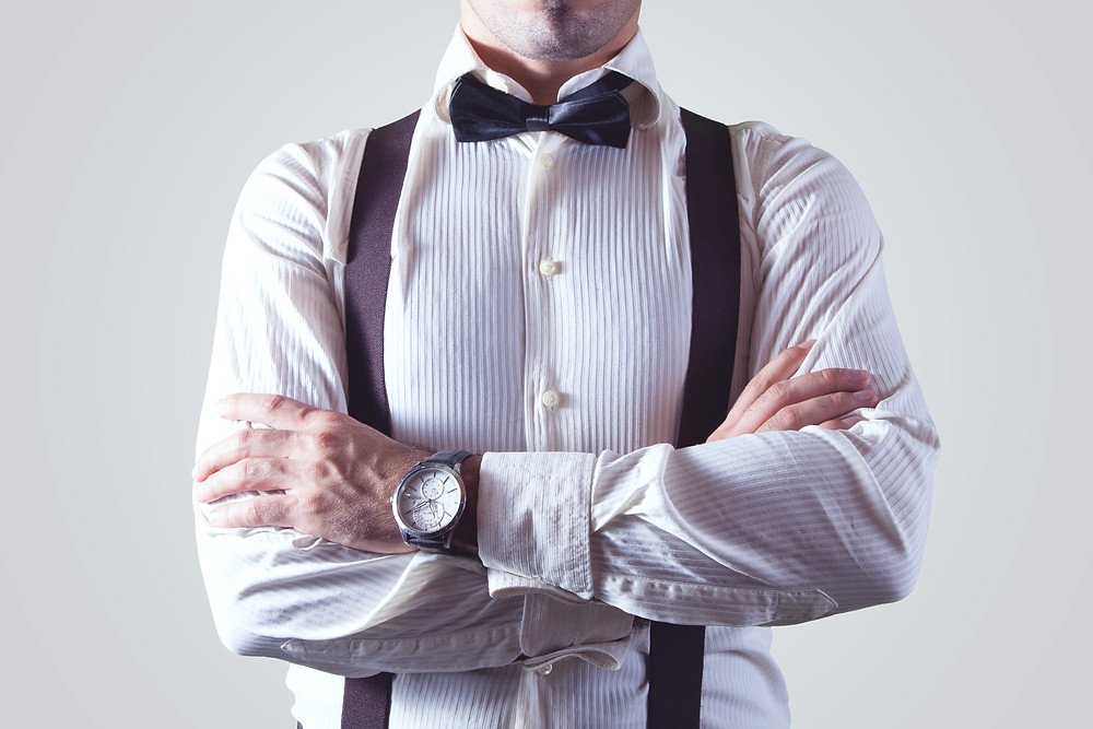 Man in shirt and bowtie with arms crossed.