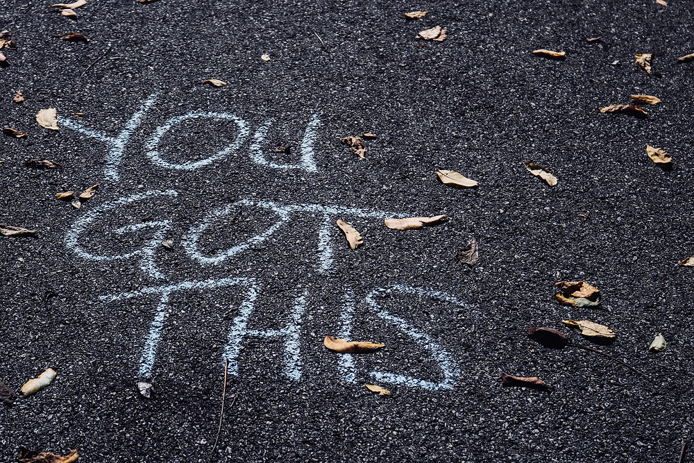 Motivational saying written on ground in chalk you got this