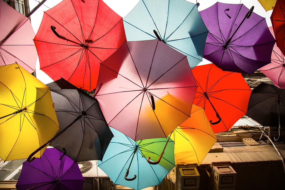 Multicolored umbrellas suspended in the air