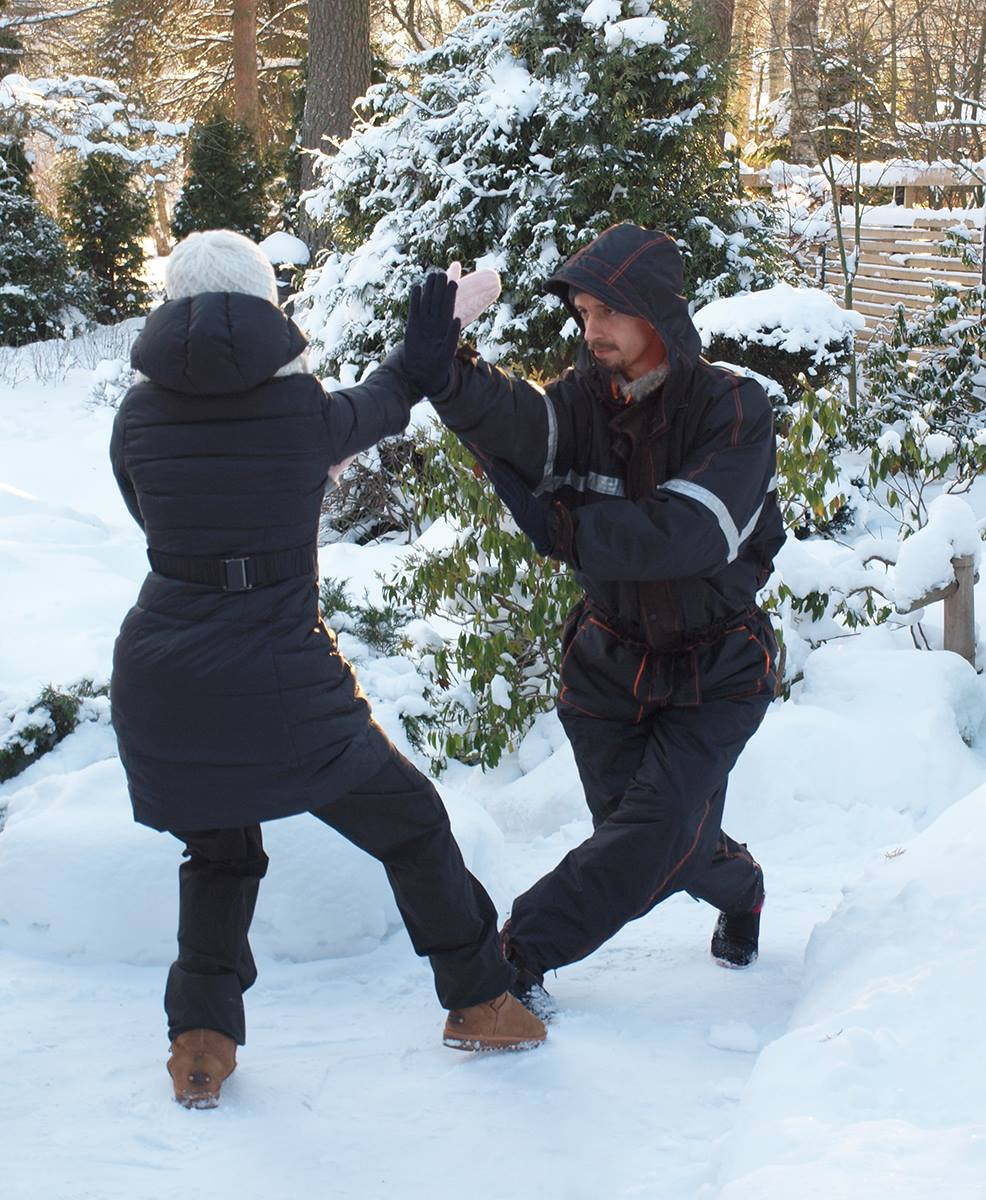 Man and woman kungfu winter snow sparring