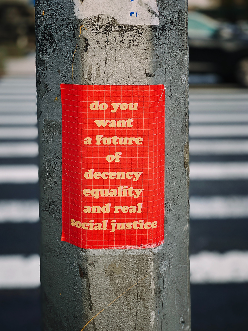 Sign on and light post social justice