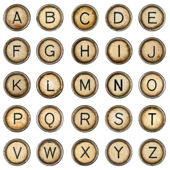 Alphabet, grunge typewriter keys in whit