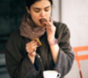 Woman Eating Cookie