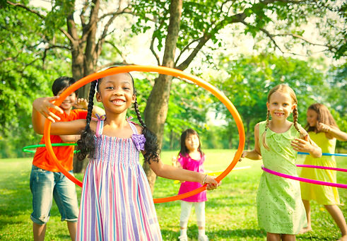 cute-diverse-kids-playing-with-hula-hoop