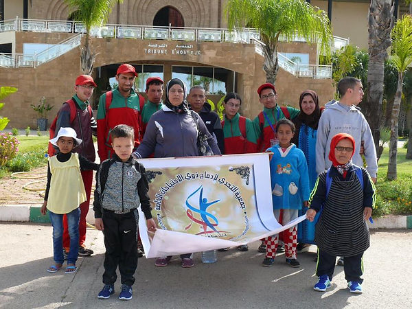 Special Olympics Team With Sign.jpg