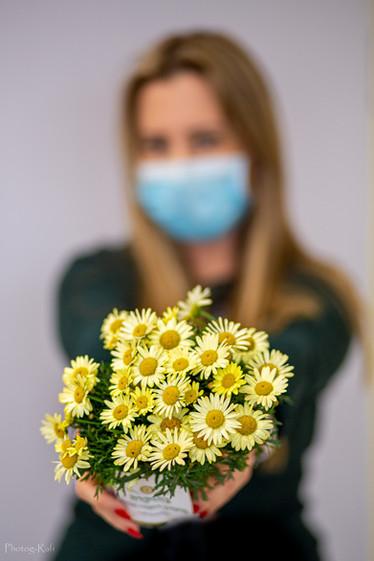 Covid 19 - handing flowers