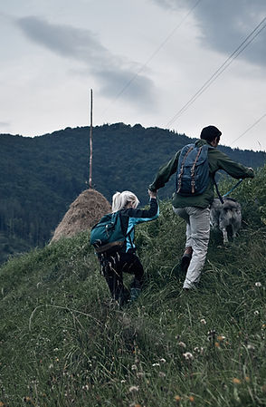 Couple Hiking with Their Dog