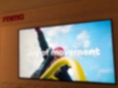 Reiman_myymälän_digital_signage_kassanäy
