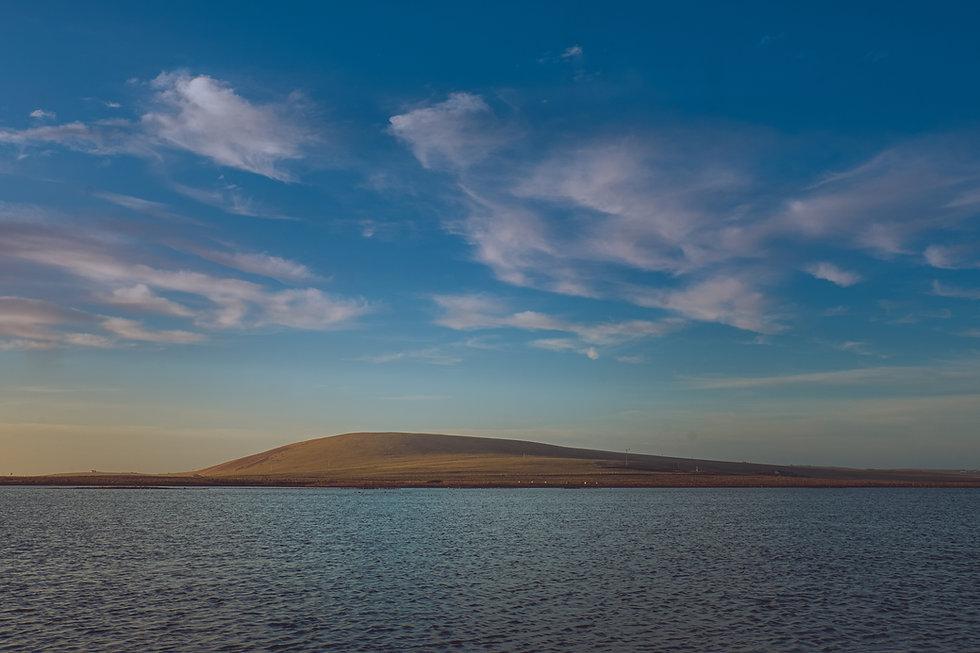 Hill under a blue sky.jpg