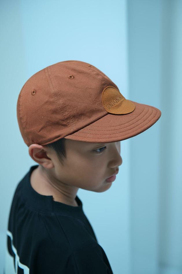 baseball cap, luminous tee