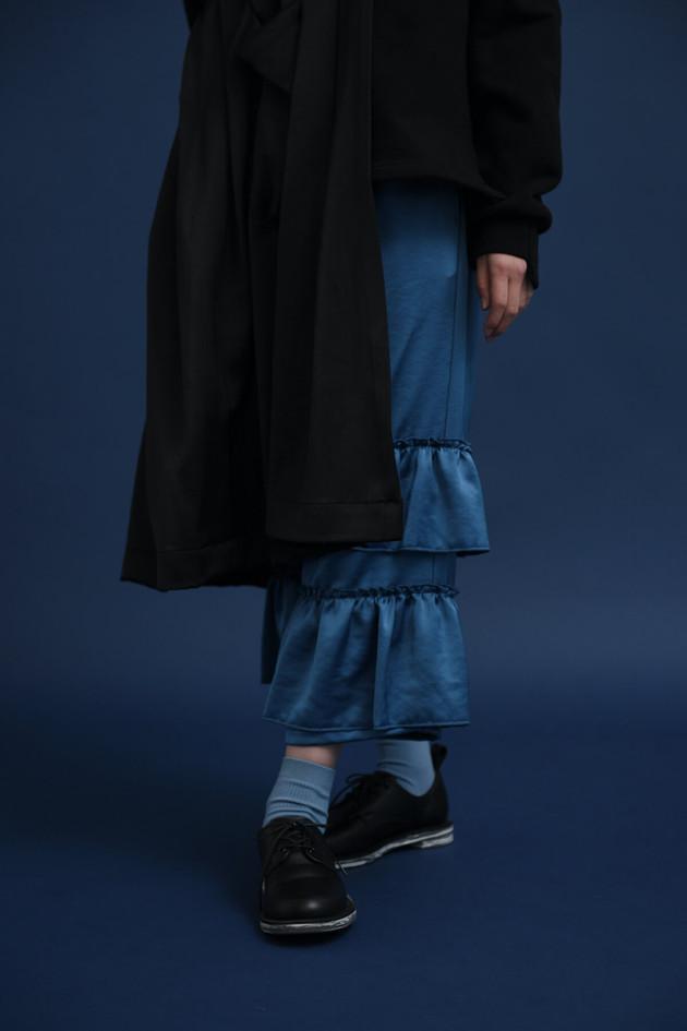 one shoulder, big heavy sweat shirt, frill long pants plain shoes