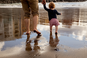 father-and-child-walking-on-the-shore-39