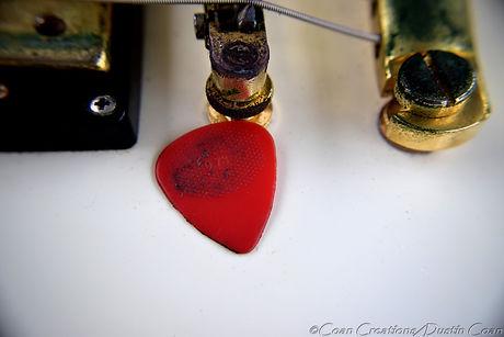 Red Pick White Guitar.JPG