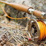 Close-up of Fly-Fishing Reel and Rod wit