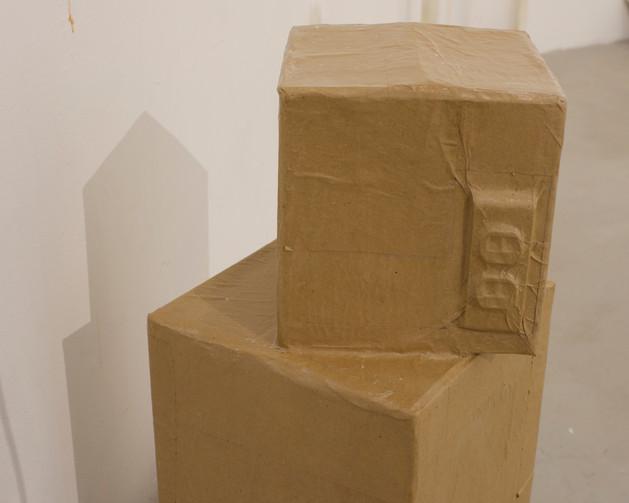 "Back of ""Two missed calls"": Butcher paper over urethane cast, glue"