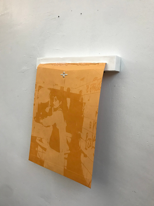 """Mia Berlin bathroom"": Manila envelope, high density clear adhesive ink, plaster cast"