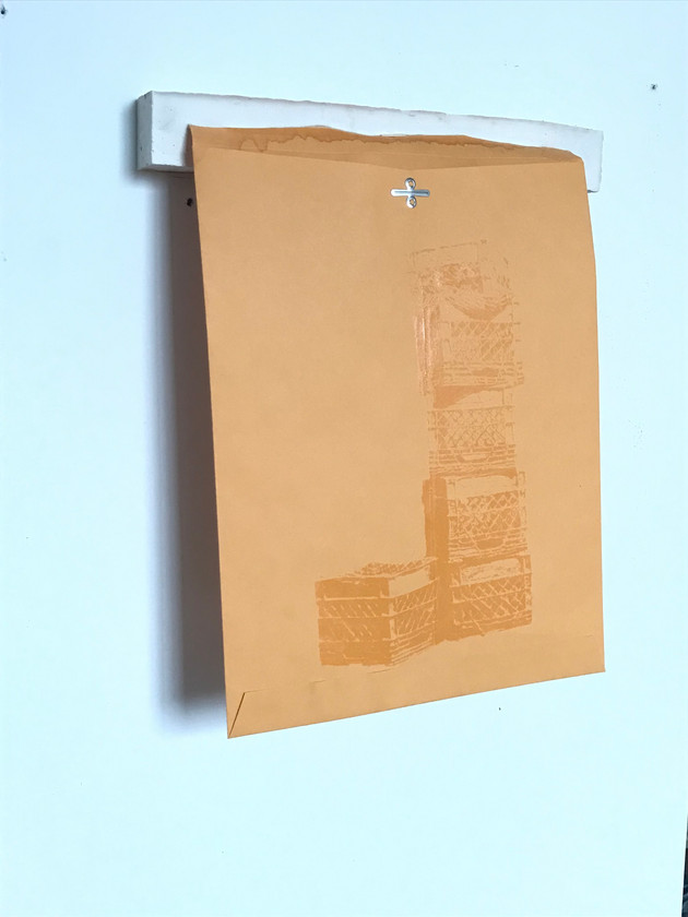 """Crates on manila"": Manila envelope, high density clear adhesive ink, plaster cast"