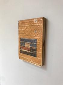 """eight pm"": Wood, inkjet print, manila envelope, cast resin, screws"