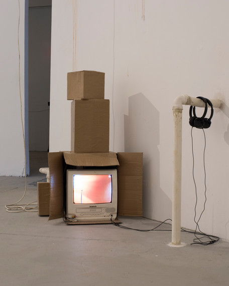 """Two missed calls"" Cardboard, butcher paper, plaster casts, headphones. 3 minute video loop"