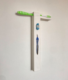 """""""Untitled (window)"""": Used toothbrushes, plaster cast, grocery receipt"""
