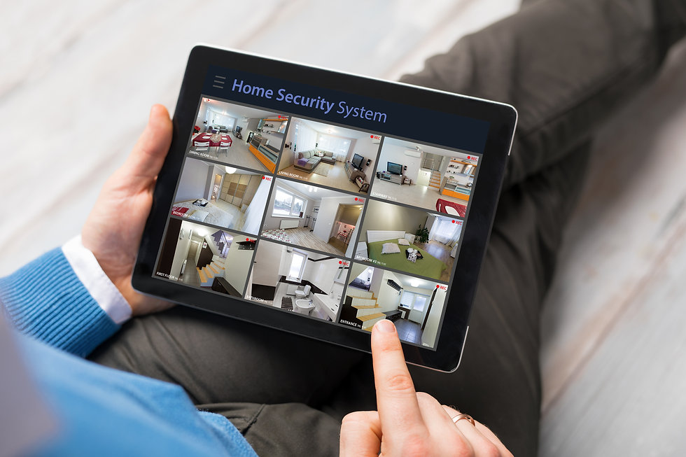 Man looking at home security cameras on