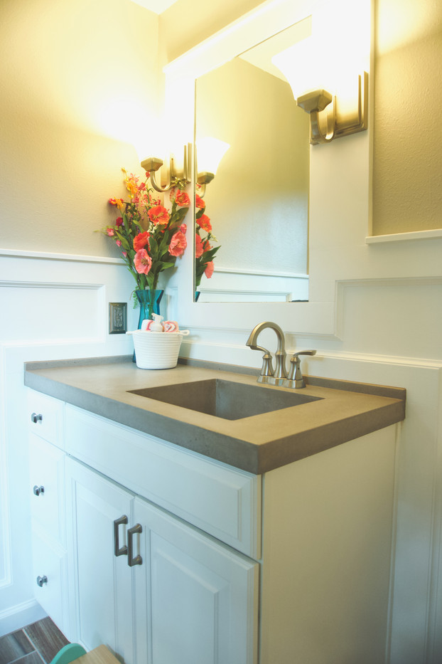 Shabby Chic Girl's Bathroom With Concrete Vanity Top With Integral Sink