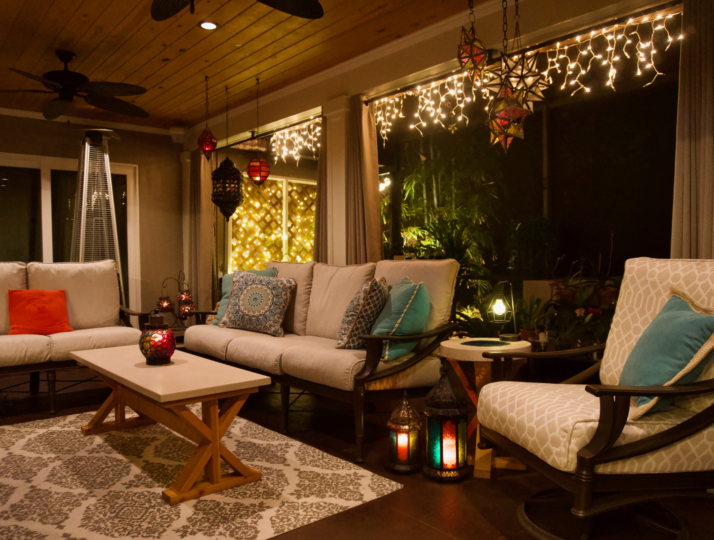 Covered Lanai Area With Concrete Coffee Table, Concrete End Table, & Concrete Planters - Night