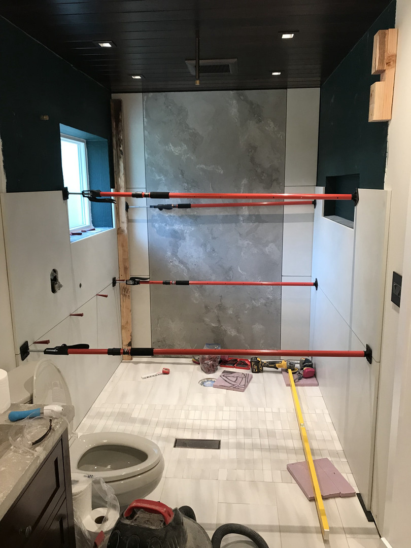 Installing Second Middle Concrete Wall Panels In Master Bathroom Wet Room