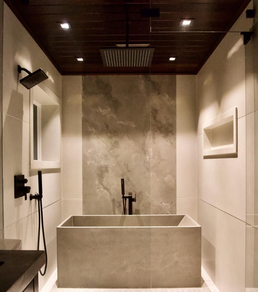 Wet Area with Concrete Bathtub, Concrete Nooks, & Concrete Wall Panels