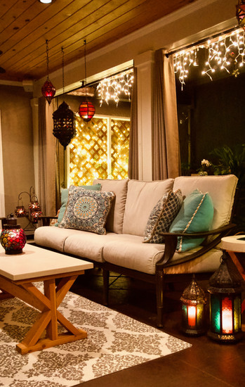 Covered Lanai at Night With Concrete Coffee Table, Concrete End Table, and Concrete Planter
