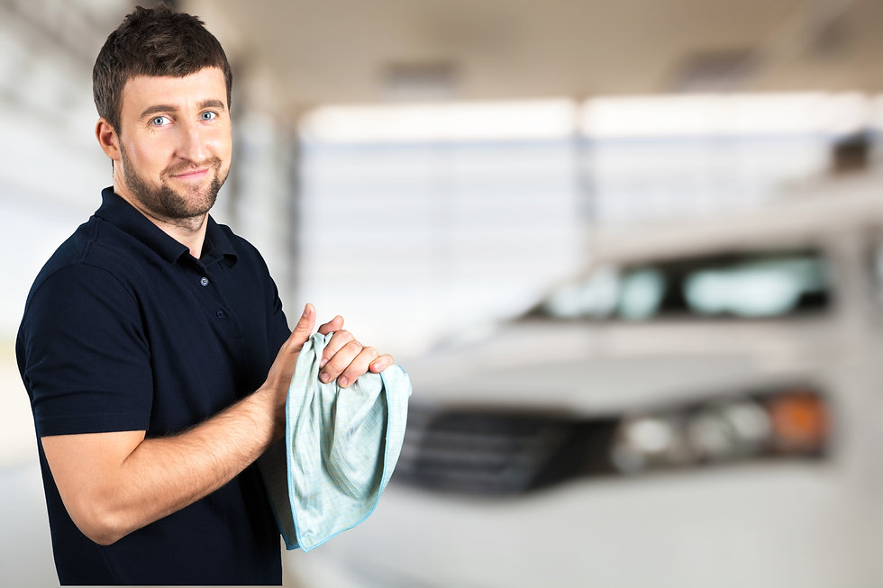 An automotive repair shop owner smiling because he is happy about his shop finanicals being in order using DriveYourKPI's program.