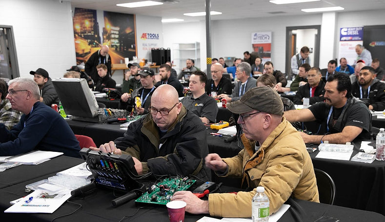 Technicians experiencing hands-on training at VISION Hi-Tech Training in Overland Park, Kansas.
