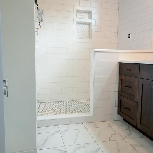 "Walls- Dal Arctic White Matte 4x8  Shower Floor & Niche  Accent- Dal Color Wheel Mosaic 1.5"" hex Matte Arctic White   Floor- Emser Contessa Dama 13x13  Builder- John F Conklin Construction"