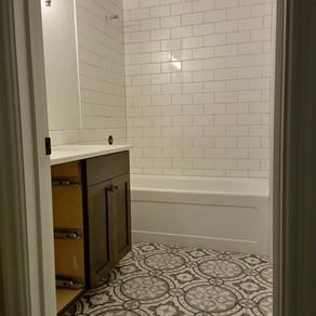 Walls- Dal Arctic White Matte 4x8  Floor- Glazzio Euro Fountain 9216 8x8  Builder- John F Conklin Construction