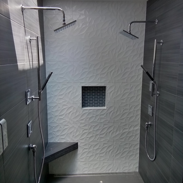 Back Wall- Emser Jazz Bloom 12x24  Side Walls- United Gazzini Met Antracite 12x24  Shower Floor- Florida Time 2.0 Carbon Natural 2x2 Mosaic  Niche Accent- Glazzio Crystile 1x3 Mosaic Eclipse  Designer- G. Christianson Construction