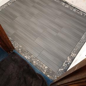 "United Tile Gazzini Met  ANTRACITE"" 12X24  Border- United Island Pebbles Aberdeen Gray 4x11 border"
