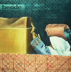 beside