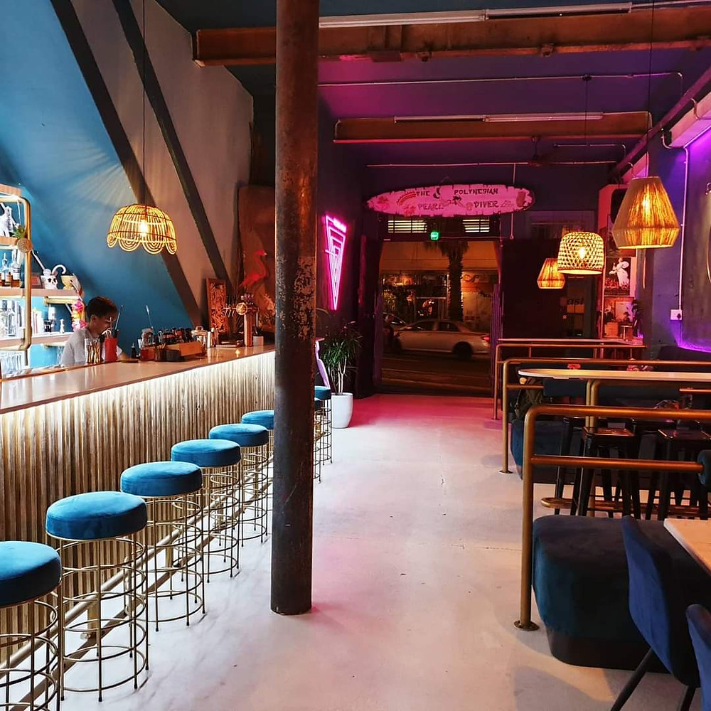 Tiki bars, are colourful, bright and filled with wood, steel and plants