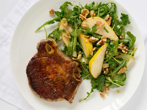 Pork Chop Over Arugula Salad