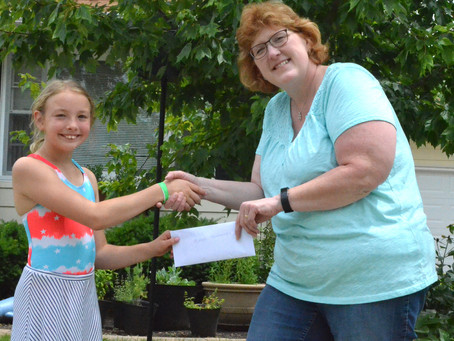 Student Noelle Sharp Makes Donation to Music Boosters