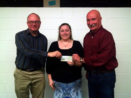 SYCAMORE MUSIC BOOSTERS RECEIVE DONATION