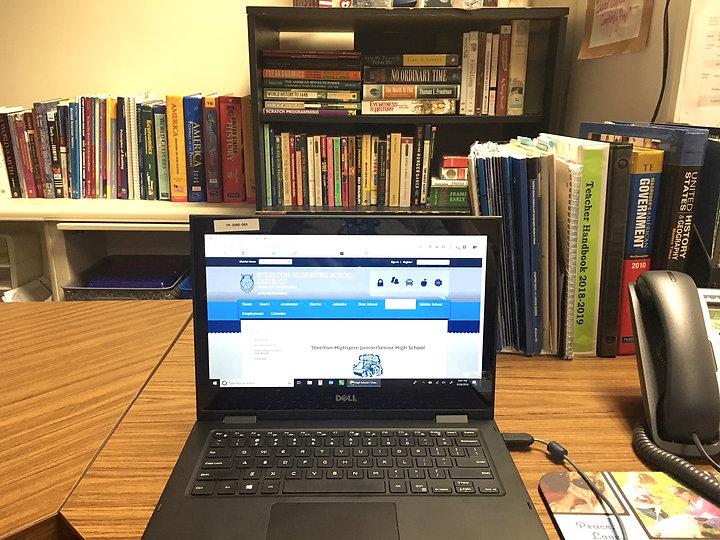 teacher's desk and bookshelf