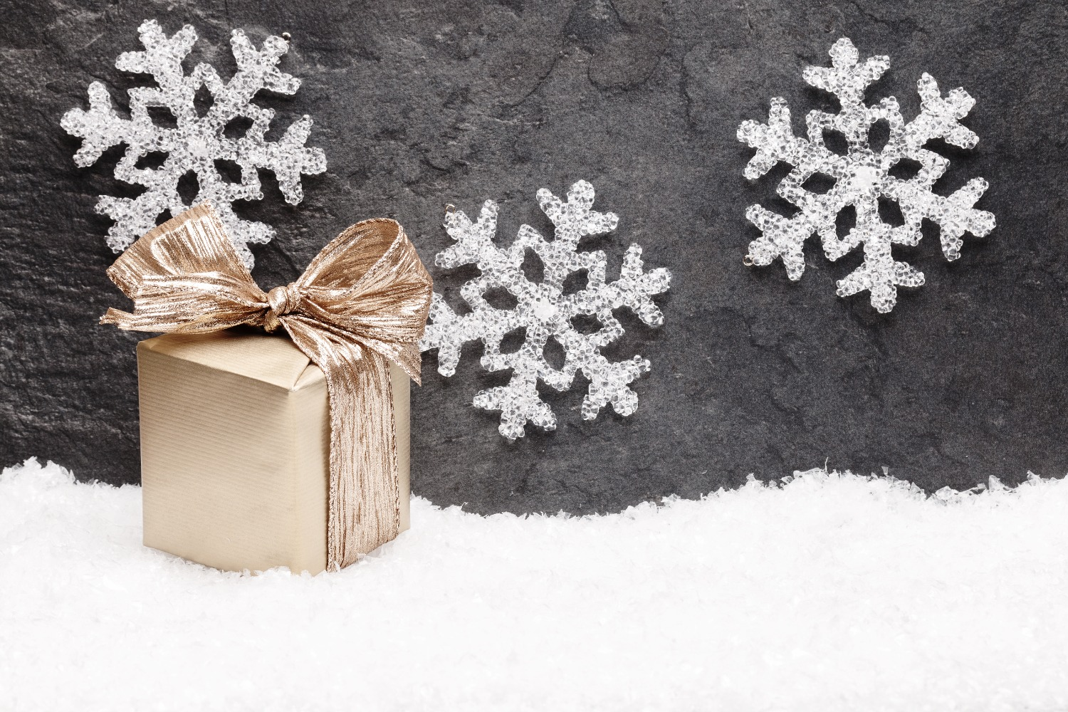 Christmas greeting card. Noel festive background. New year symbol. Gold gift box on snow._edited