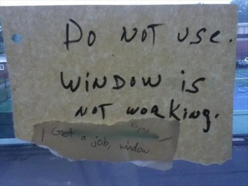 broken window with sign that says window not working