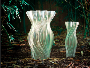 2 Transparent spiraling wavy vases in a bambo forest