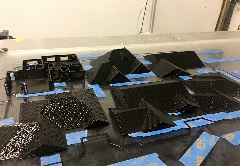 Single floor plan model and multiple different  roof styles on the bed of a 3D printer