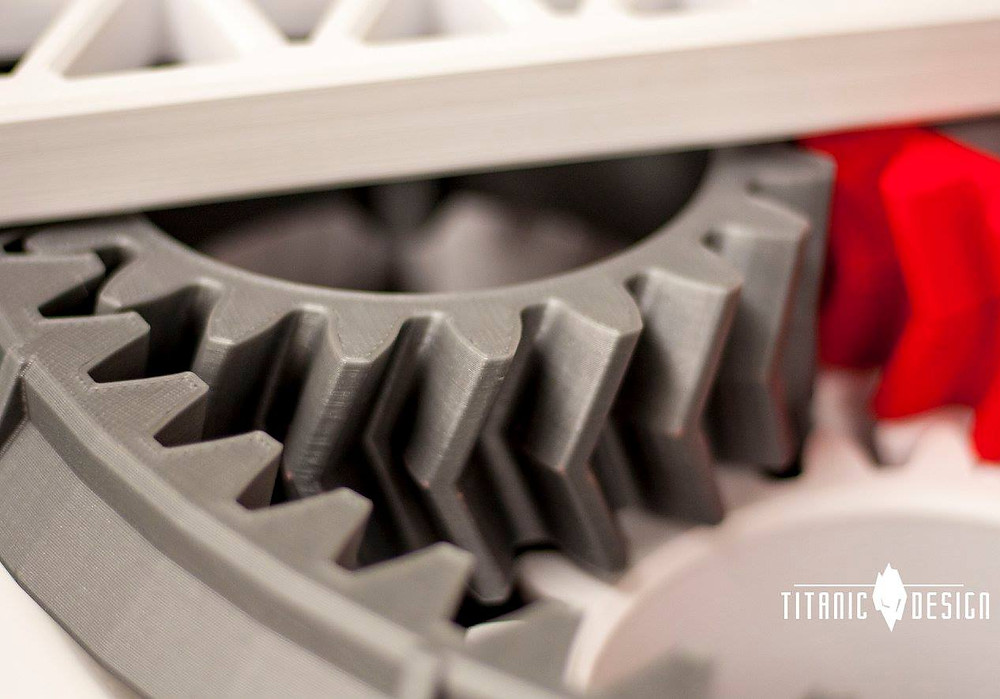 A close up of a 3D printed multi colored planetary gearset